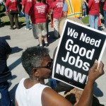 "A sign reads ""We Need Good Jobs NOW!"" at an AFL-CIO rally in 2012"