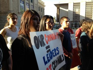 "Two high-school voting volunteers hold a sign saying ""We are Leaders, Not Felons"" at a rally outside the Arizona State Senate building on Feb. 28, 2013 to express concern over proposed elections reforms."