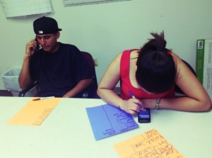 High school students phone bank their neighbors to build support for immigration reform.